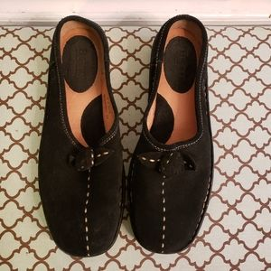 Born leather slip on shoes. Black leather